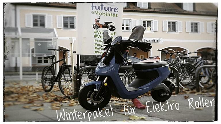 Elektroroller NIU M Sport in blau im Winteroutfit